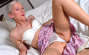 image Two horny lesbians plays with a dildo