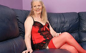 Blistering mature slut masturbaying on someones skin couch