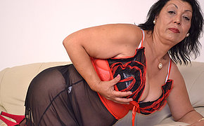 This horny mammy loves to get wet on her couch
