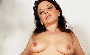 This horny mature floozy loves a younger cock inside her