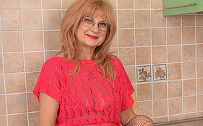 Horny grandma shows hot body and masturbates
