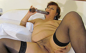 This chubby mature hussy loves to play on her bed