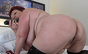 This big mama sure loves her hard dildo