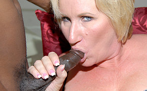 Kinky MILF getting two black cocks at once