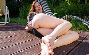 Horny housewife masturbating outdoors