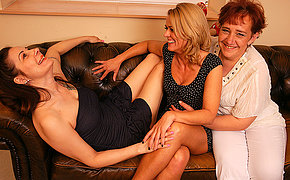 Three lesbian housewives getting wet on the sofa