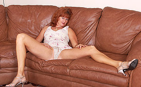 Horny British mom playing on her sofa