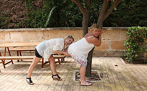 Two horny German lesbian houswives getting each others pussies wet