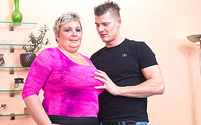 Big breasted mature BBW fucking and sucking her younger lover