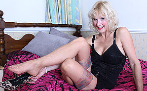 Horny British mature lady getting wet on her bed