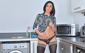 Sexy British mom getting naughty in the kitchen