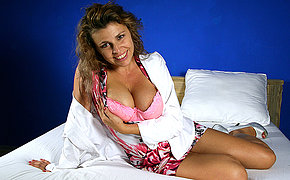 Naughty housewife with a rocking body playing on bed