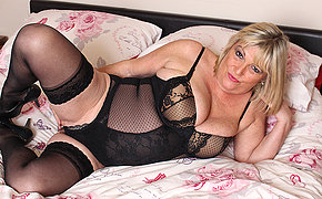Big breasted chubby mature lady playing with herself