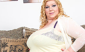 Huge breasted mature lady playing with her vagina