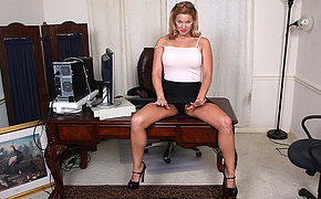 Naughty American MILF playing with her vagina at the office