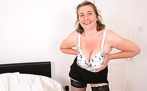 Naughty big breasted British housewife playing with her pussy