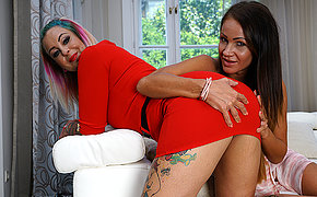 One hot MILF having fun with a kinky tatooed MILF