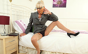 Naughty mature whore playing with her toy