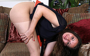 Naughty American mommy playing on the couch