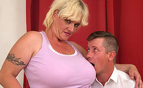 Big breasted mature lady sucking a hard cock