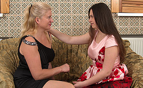 Naughty MILF having fun with an unshaved lesbian teen