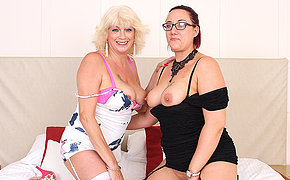 Two horny mature ladies licking and playing with each other