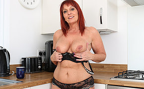 British Milf Beau Diamonds strips off her clothes and plays with her pussy