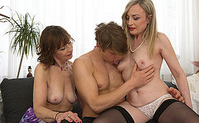 Two mature housewives share their toyboys load of shit