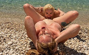 Horny British Milf and her young girlfriend enjoy each others pussies on the beach